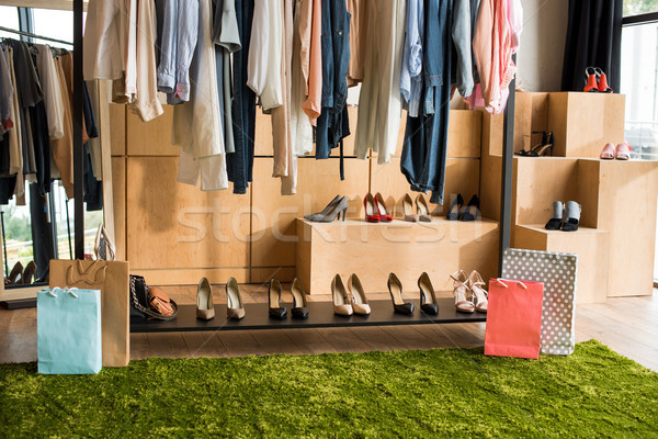 shoes and clothes in boutique Stock photo © LightFieldStudios