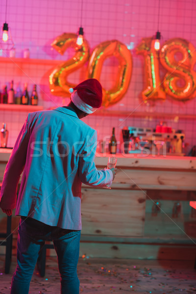man in santa claus hat Stock photo © LightFieldStudios