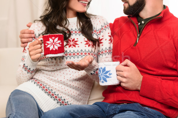 couple with cups at christmastime Stock photo © LightFieldStudios