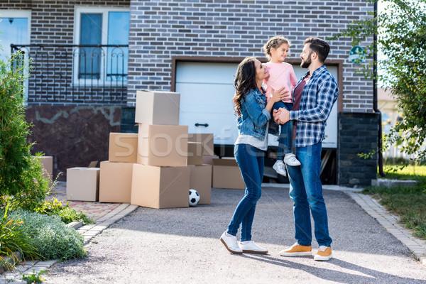 family in front of new house Stock photo © LightFieldStudios