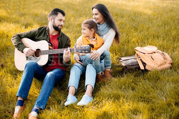 Family relaxing in park Stock photo © LightFieldStudios
