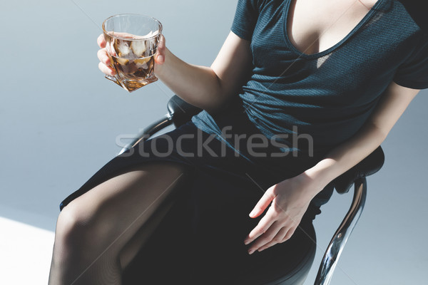 young woman drinking whiskey     Stock photo © LightFieldStudios