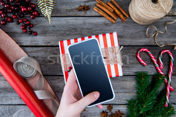 smartphone in hand Stock photo © LightFieldStudios