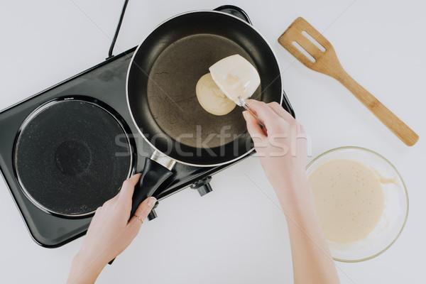 Erschossen Person Kochen Pfannkuchen Pfanne grau Stock foto © LightFieldStudios