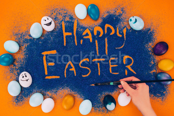 cropped image of woman making easter decoration with painted eggs Stock photo © LightFieldStudios