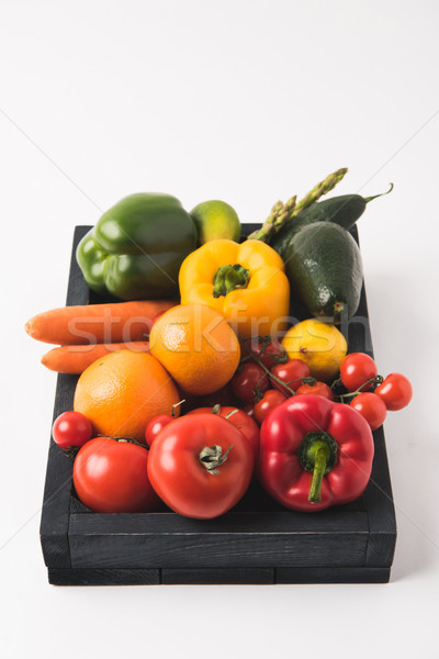 Raw colorful vegetables and fruits in dark wooden box isolated on white background Stock photo © LightFieldStudios