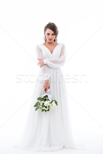 beautiful bride posing in white dress with wedding bouquet and looking at camera, isolated on white Stock photo © LightFieldStudios