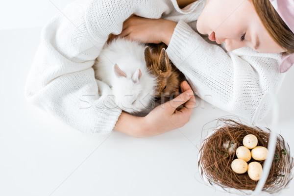 Shot meisje konijnen mand paaseieren Stockfoto © LightFieldStudios