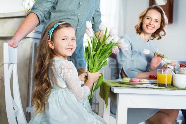 Little girl holding bouquet Stock photo © LightFieldStudios
