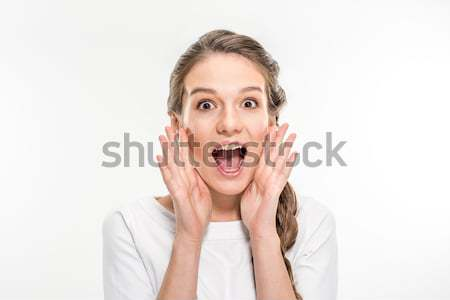Exited young woman  Stock photo © LightFieldStudios