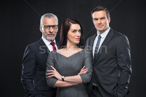 Drie portret naar camera achtergrond Stockfoto © LightFieldStudios
