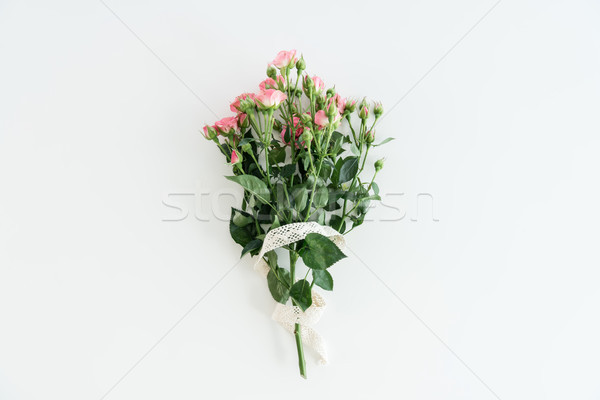 pink roses bouquet with ribbon isolated on white with copy space, wedding flowers bouquet concept Stock photo © LightFieldStudios