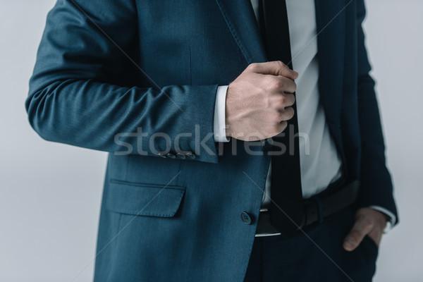 Középső rész üzletember elegáns öltöny pózol szürke Stock fotó © LightFieldStudios
