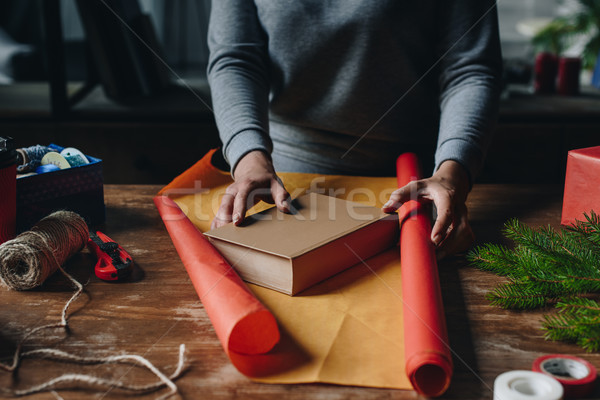 woman wrapping book as christmas gift Stock photo © LightFieldStudios