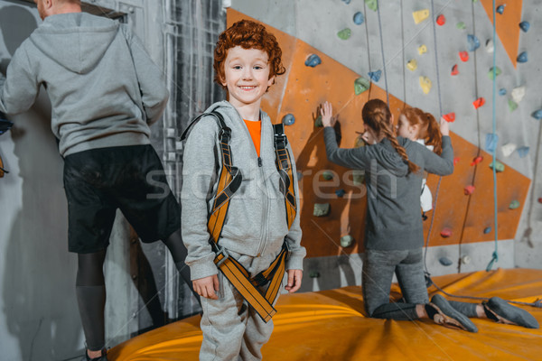 boy in climbing harness at gym Stock photo © LightFieldStudios
