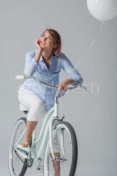 Sonhador menina sessão bicicleta feliz branco Foto stock © LightFieldStudios
