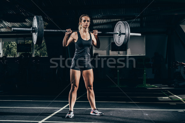 Barbell jonge atletisch gymnasium Stockfoto © LightFieldStudios