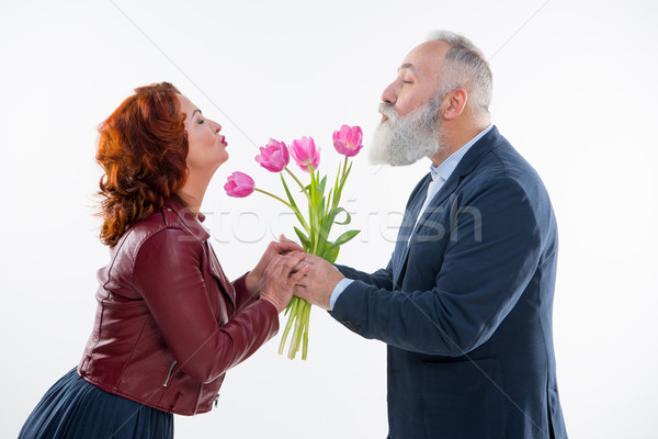 Man presenting flowers to woman   Stock photo © LightFieldStudios