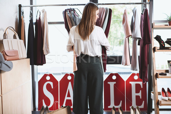 shopaholic with clothes and shopping bags Stock photo © LightFieldStudios