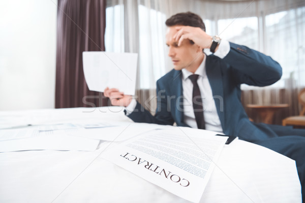 businessman reading paperwork Stock photo © LightFieldStudios
