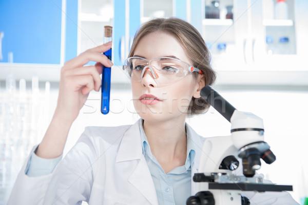 Bilim adamı bakıyor deney tüpü genç kadın kimyasal Stok fotoğraf © LightFieldStudios