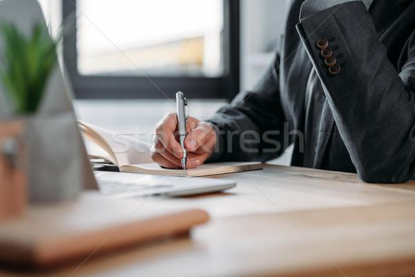 üzletember jegyzetel notebook közelkép kilátás munkahely Stock fotó © LightFieldStudios
