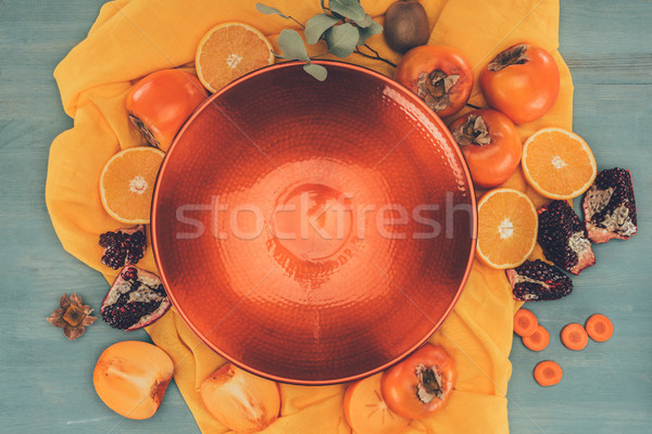 Haut vue rouge plaque fruits orange Photo stock © LightFieldStudios