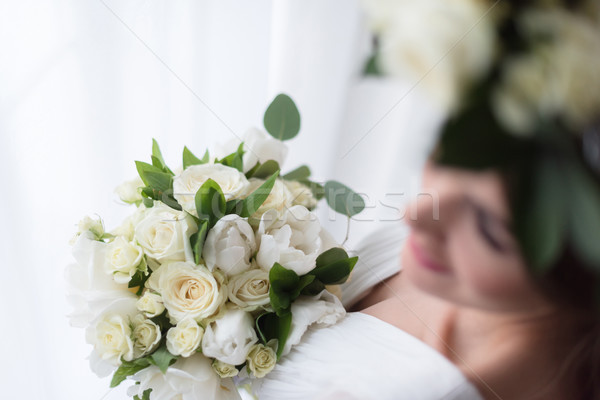 overhead view of elegant bride with white wedding bouquet Stock photo © LightFieldStudios