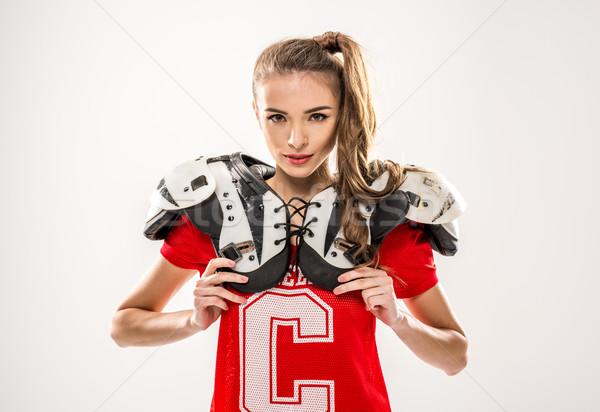 Vrouwelijke voetballer naar camera grijs sport Stockfoto © LightFieldStudios