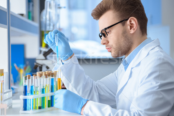 Side view of chemist making experiment in laboratory  Stock photo © LightFieldStudios
