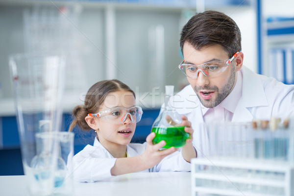 Professor estudante cientistas óculos trabalhando químico Foto stock © LightFieldStudios