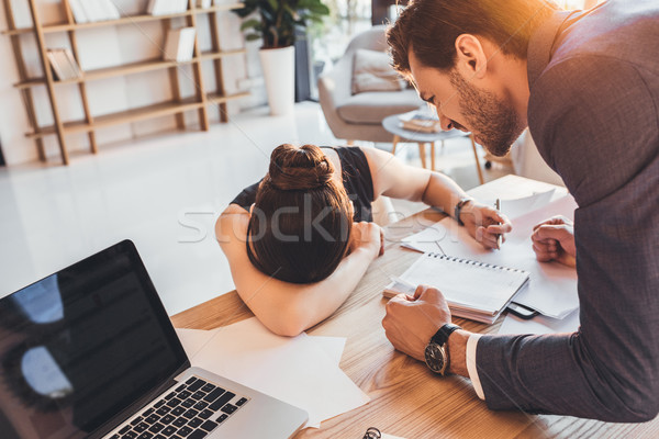 Young secretery crying on desk  Stock photo © LightFieldStudios