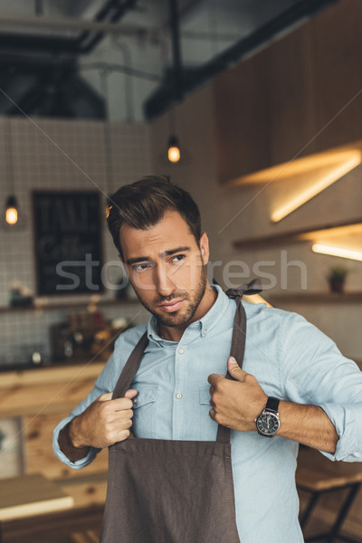 worker wearing apron Stock photo © LightFieldStudios