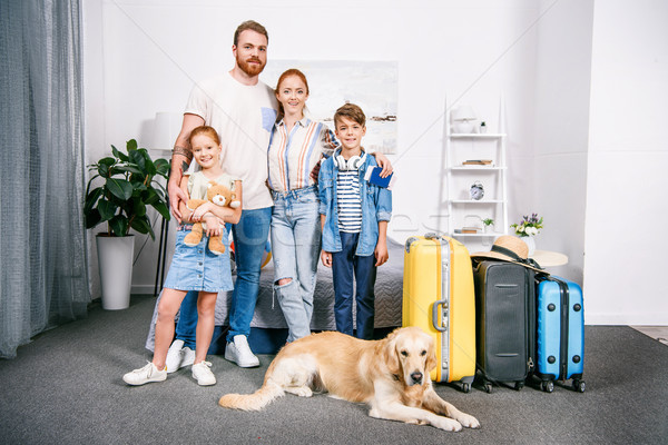 family with dog ready for trip Stock photo © LightFieldStudios