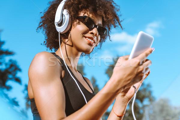 Sportive african-american woman in headphones Stock photo © LightFieldStudios