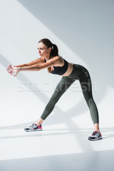 Stock photo: woman stretching before workout