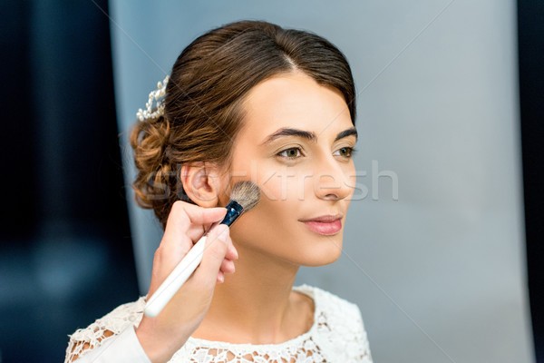 woman getting makeup done Stock photo © LightFieldStudios