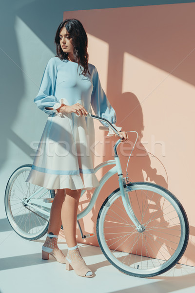Woman in fashionable turquoise dress with bicycle Stock photo © LightFieldStudios