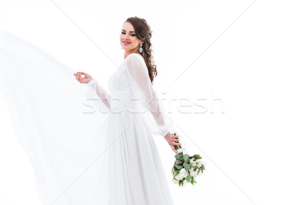 happy beautiful bride posing in white dress with wedding bouquet, isolated on white Stock photo © LightFieldStudios