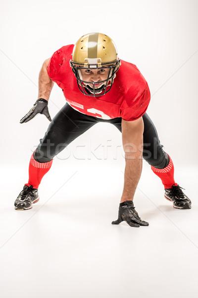 Futballista sportruha amerikai néz kamera szürke Stock fotó © LightFieldStudios