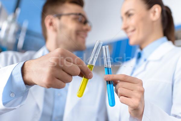 Mosolyog tudósok mutat laboratórium csövek fókusz Stock fotó © LightFieldStudios