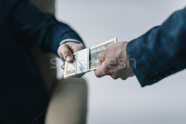 partial view of businessman taking money from colleague  Stock photo © LightFieldStudios