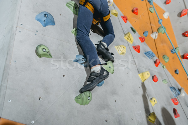 little boy climbing wall with grips Stock photo © LightFieldStudios