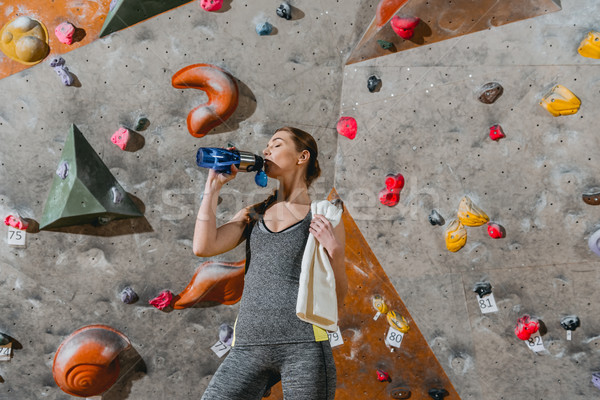 Sportive woman drinking water Stock photo © LightFieldStudios