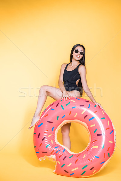woman in swimsuit with doughnut pool float Stock photo © LightFieldStudios