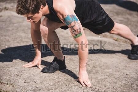 Stock photo: man exercising on slabs
