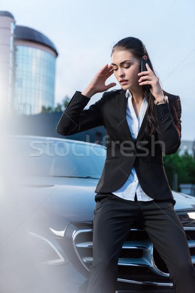Problémás üzletasszony beszél telefon fiatal ül Stock fotó © LightFieldStudios