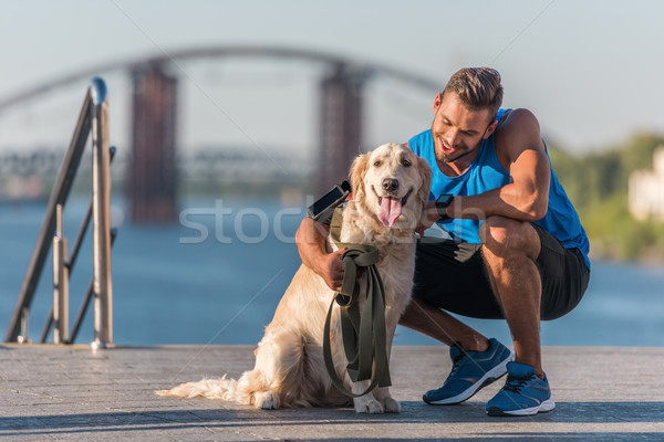 sportswoman with dog on quay Stock photo © LightFieldStudios