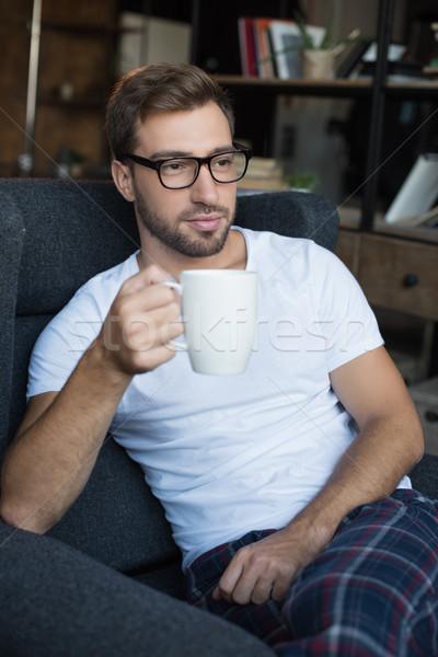 Man beker koffie jonge knappe man Stockfoto © LightFieldStudios