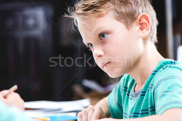 Stock photo: Concentrated schoolchild studying